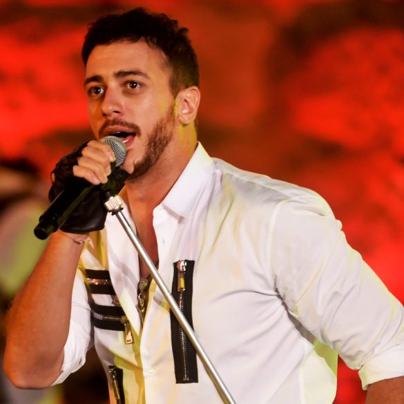 Morocco singer Saad Lamjarred(C) performs during the 52 sesion of the International Carthage Festival on July 30, 2016 at the romain theatre of carthage near Tunis. / AFP PHOTO / FETHI BELAID