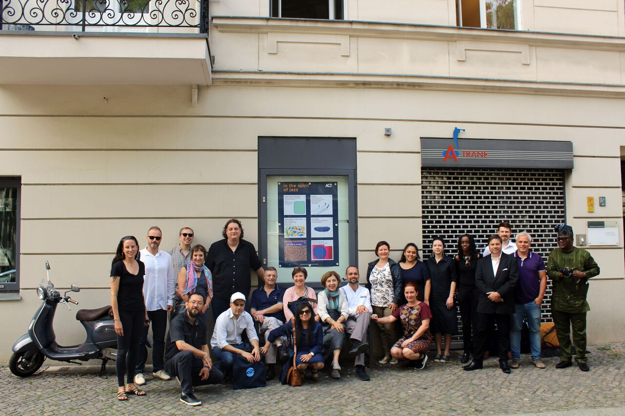 jazz from germany participants in a group photo with ACT label officials in front of Popular A-Trane Jazz Club Berlin