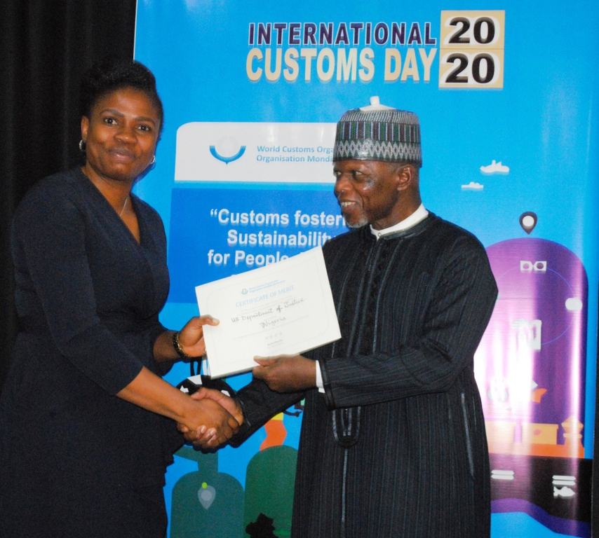 The CGS, Col. Hameed Ali Rtd. presents a Certificate of Merit in recognition of the United States Department of Justice (USDoJ) to Mrs.Bisi Olabanji (L),a Legal Advisor representing USDoJ-OPDAT of the US Mission, Nigeriaduring the 2020 International Customs Day celebration in Abuja.